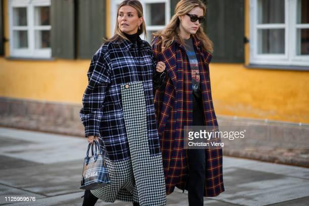 Janka Polliani is seen wearing two tone plaid coat Balenciaga bag and Annabel Rosendahl wearing plaid coat outside Resume during the Copenhagen...