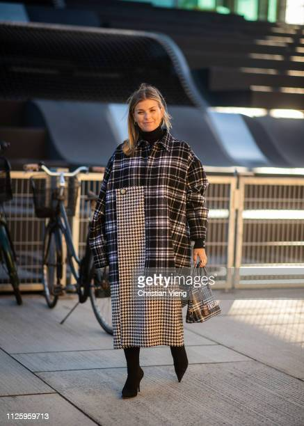 Janka Polliani is seen wearing two tone plaid coat Balenciaga bag outside Resume during the Copenhagen Fashion Week Autumn/Winter 2019 Day 1 on...