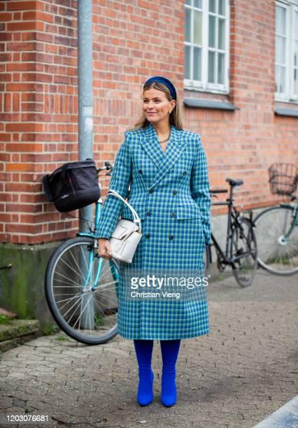 Janka Polliani seen wearing blue checkered coat outside By Malene Birger during Copenhagen Fashion Week Autumn/Winter 2020 Day 3 on January 30, 2020...