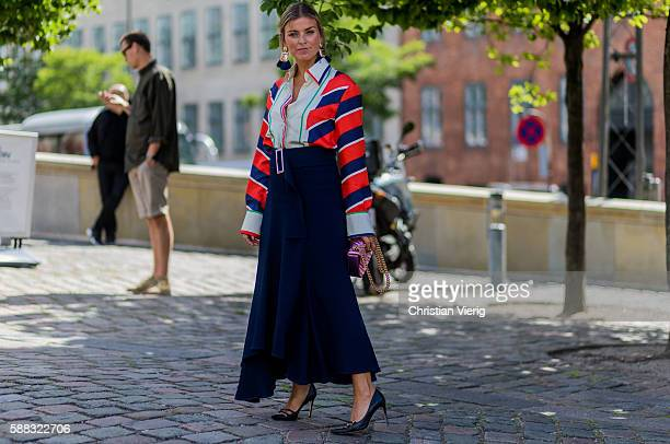 Janka Polliani wearing a Celine shirt and pink Gucci bag outside Freya Dalsjo during the first day of the Copenhagen Fashion Week Spring/Summer 2017...