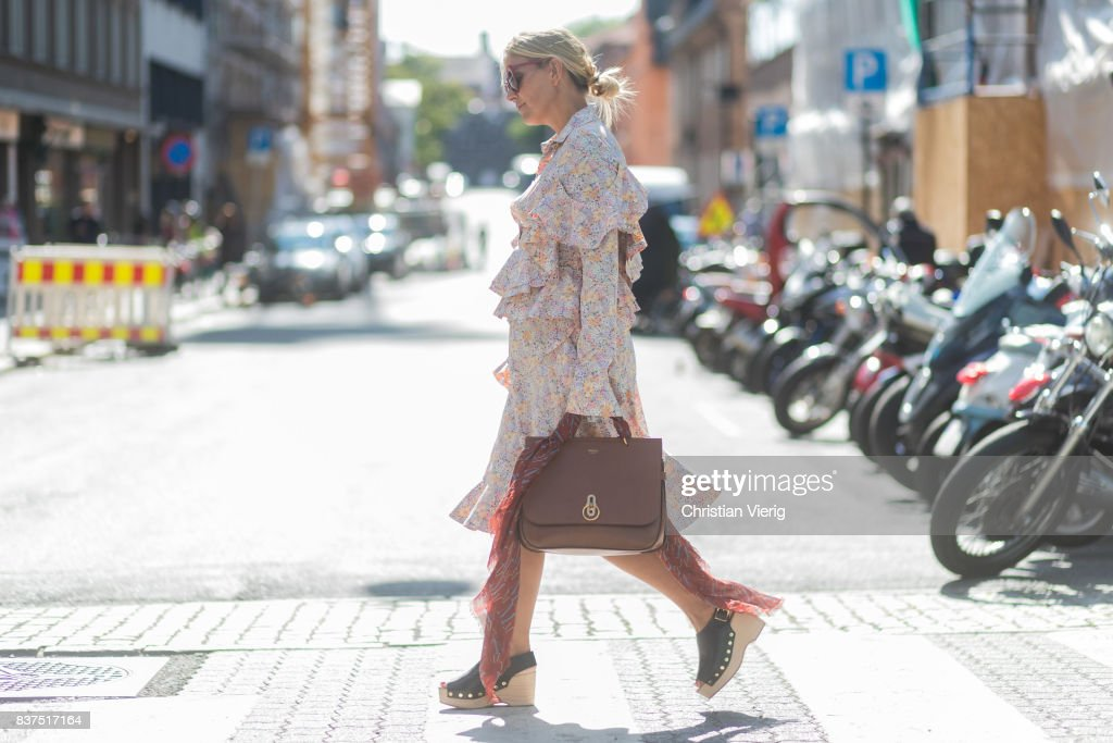 Janka Polliani wearing a dress, brown Mulberry bag outside Moods of Norway on August 22, 2017 in Oslo, Norway.