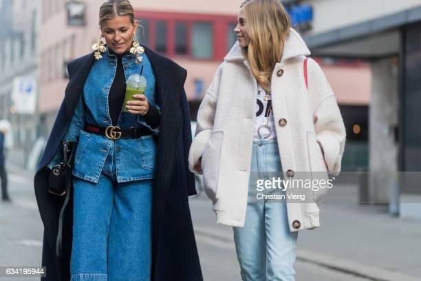 Janka Polliani wearing a Gucci belt denim jacket denim pants navy coat Loewe bag and Tine Andrea wearing a white jacket tshirt denim jeans red bag on...