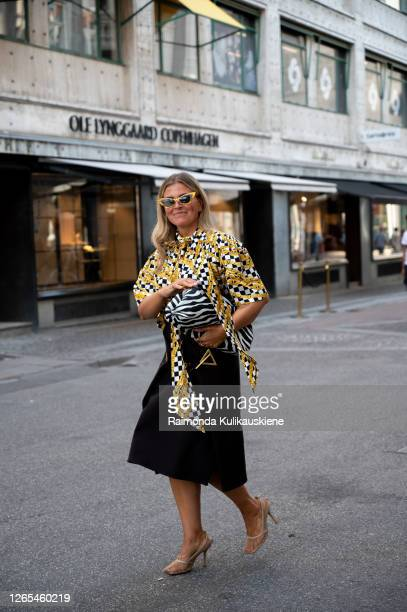 Janka Polliani wearing black skirt and yellow/black shirt outside Lovechild 1979 during Copenhagen fashion week SS21 on August 11, 2020 in...