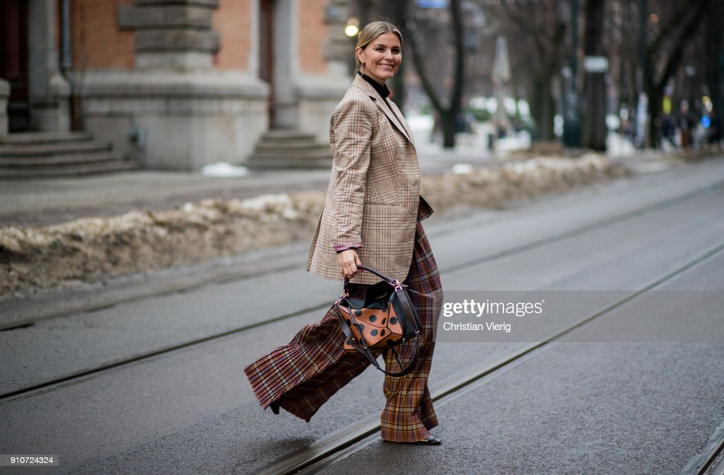 Janka Polliani wearing checked wide leg pants, Lowe bag, checked blazer is seen outside by TiMo on January 26, 2018 in Oslo, Norway.