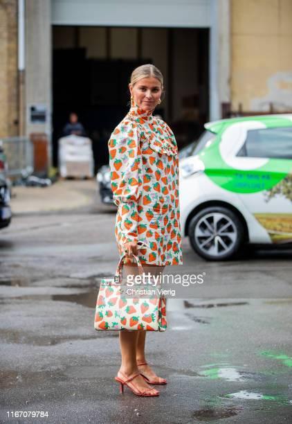 Janka Polliani wearing dress and bag with print seen outside Baum und Pferdgarten during Copenhagen Fashion Week Spring/Summer 2020 on August 08,...