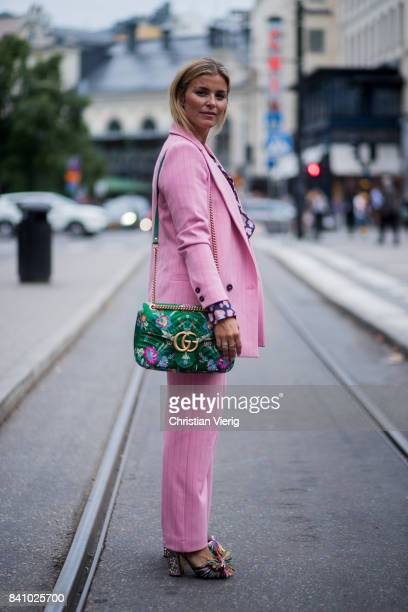Janka Polliani wearing green Gucci bag pink suit outside Rodebjer on August 30 2017 in Stockholm Sweden
