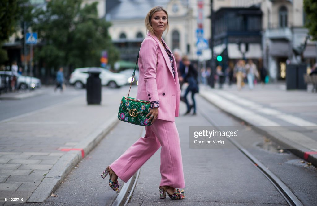 Janka Polliani wearing green Gucci bag, pink suit outside Rodebjer on August 30, 2017 in Stockholm, Sweden.