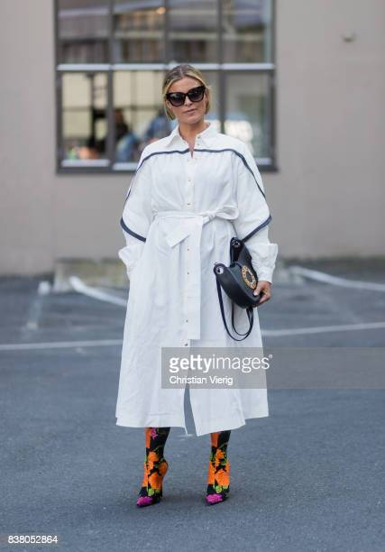 Janka Polliani wearing Loewe bag white dress Balenciaga sock boots outside FWSS on August 23 2017 in Oslo Norway
