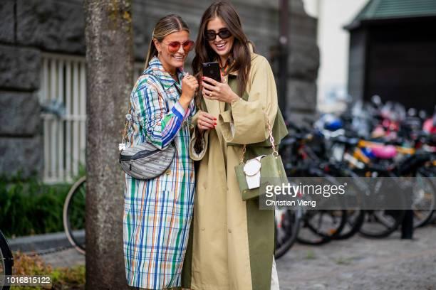 Janka Polliani wearing multi color checked coat Balenciaga belt bag high waist wide leg pants and Darja Barannik wearing beige trench coat with slits...