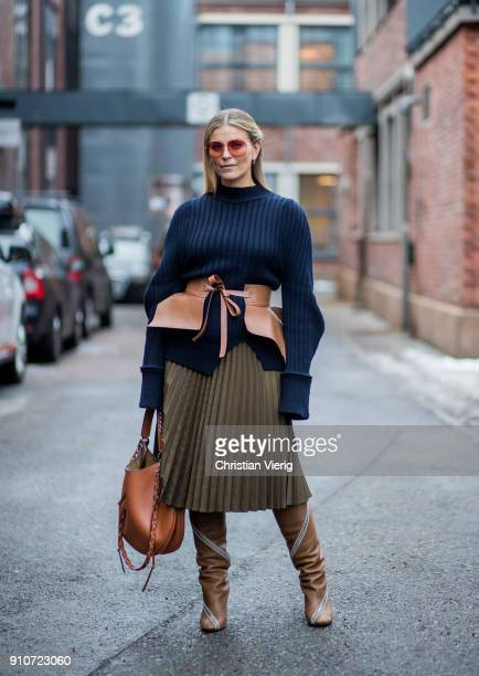 Janka Polliani wearing navy knit olive skirt Loewe bag corset brown boots is seen outside Line of Oslo on January 26 2018 in Oslo Norway