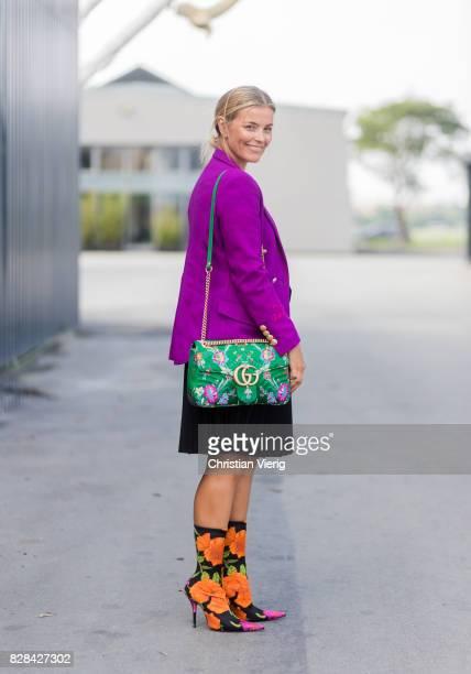 Janka Polliani wearing purple blazer Balenciaga boots Gucci bag outside By Malene Birger on August 09 2017 in Copenhagen Denmark