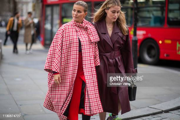 Janka Polliani wearing red plaid coat and Annabel Rosendahl wearing bordeaux leather coat is seen outside Erdem during London Fashion Week February...