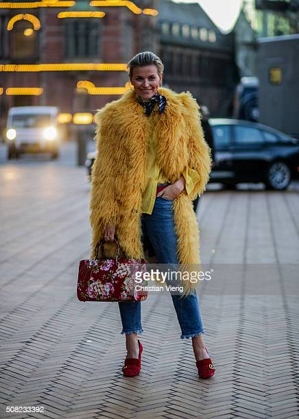 Janka Polliani wearing Saks Potts coat Gucci bag and shoes outside Lala Berlin during the Copenhagen Fashion Week Autumn/Winter 2016 on February 3...