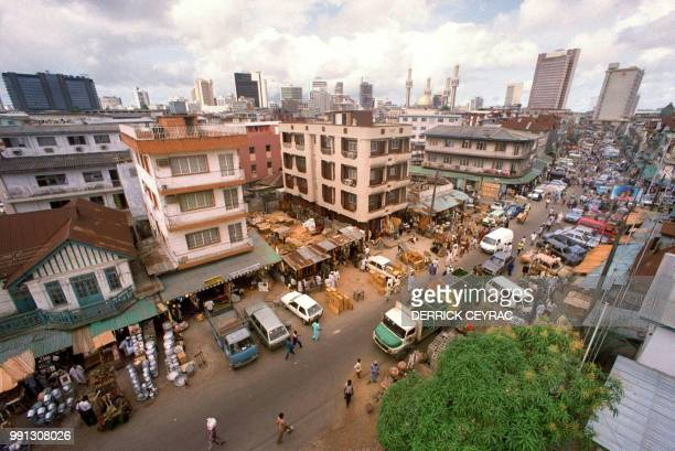 Jankara market located on Lagos Island and the skyline of the city of Lagos May 1991