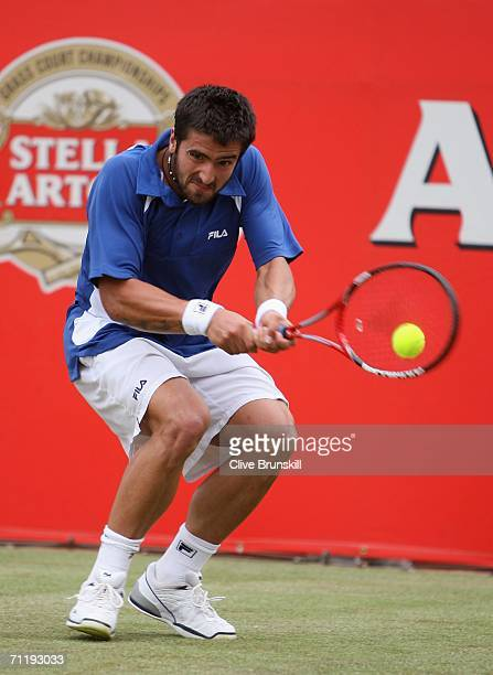 Janko Tipsarevic of Serbia and Montenegro in action against Andy Murray of Great Britain during the Stella Artois Championships at Queen's Club on...