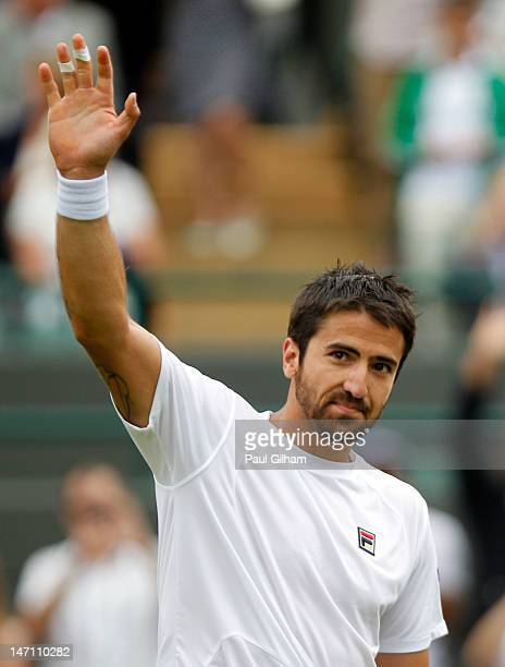 Janko Tipsarevic of Serbia ceelebrates match point after his gentlemen's first round singles match against David Nalbandian of Argentina on day one...