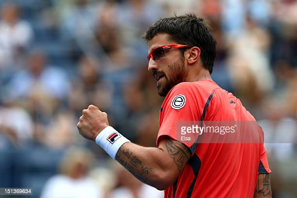 Janko Tipsarevic of Serbia celebrates a point against David Ferrer of Spain during their men's singles quarterfinal match on Day Eleven of the 2012...
