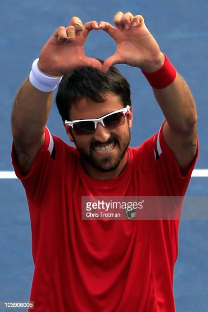 Janko Tipsarevic of Serbia celebrates defeating Juan Carlos Ferrero of Spain during Day Eight of the 2011 US Open at the USTA Billie Jean King...