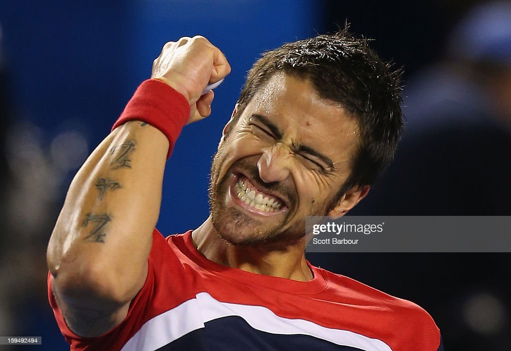 Janko Tipsarevic of Serbia celebrates winning his first round match against Lleyton Hewitt of Australia during day one of the 2013 Australian Open at Melbourne Park on January 14, 2013 in Melbourne, Australia.