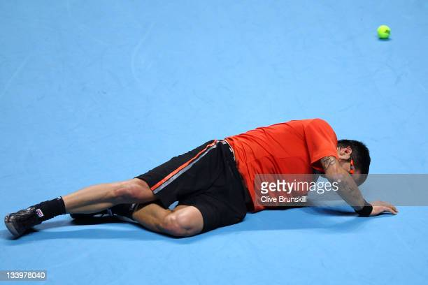 Janko Tipsarevic of Serbia falls during the men's singles match against Tomas Berdych of Czech Republic during the Barclays ATP World Tour Finals at...