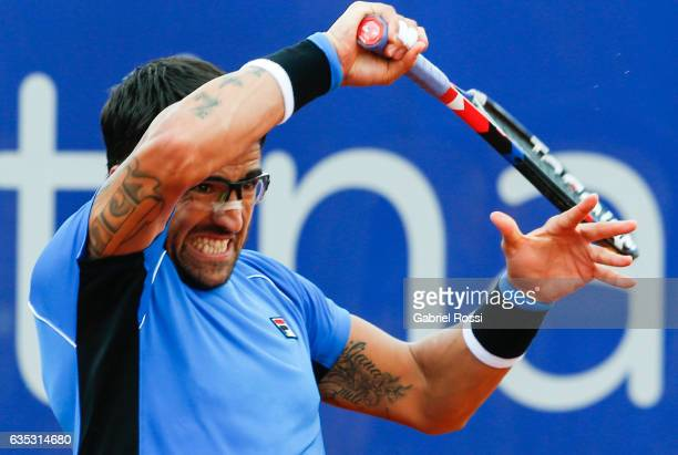 Janko Tipsarevic of Serbia gestures after taking a forehand shot during a first round match between Alexandr Dolgopolov of Ukraine and Janko...