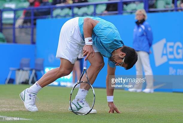 Janko Tipsarevic of Serbia goes down injured in his final against Andreas Seppi of Italy during day 8 of the AEGON International tennis tournament on...