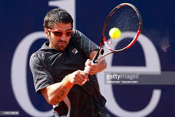 Janko Tipsarevic of Serbia plays a back hand during his semi finale match against Thomaz Bellucci of Brazil during the Mercedes Cup 2012 at the TC...