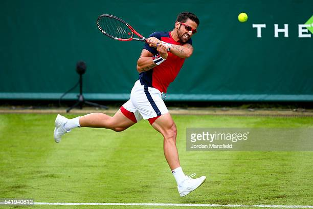 Janko Tipsarevic of Serbia plays a backhand during his match against Nicolas Almagro of Spain during day one of The Boodles Tennis Event at Stoke...