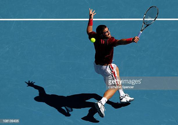 Janko Tipsarevic of Serbia plays a backhand during his second round match against Fernando Verdasco of Spain during day three of the 2011 Australian...