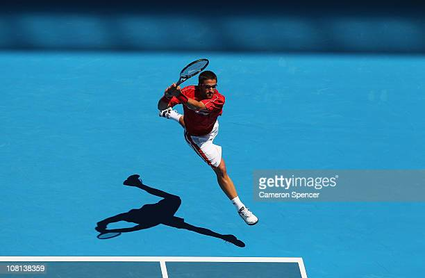 Janko Tipsarevic of Serbia plays a backhand in his second round match against Fernando Verdasco of Spain during day three of the 2011 Australian Open...