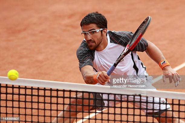Janko Tipsarevic of Serbia plays a fore hand during his finale match against Juan Monaco of Argentinia during day 6 of Mercedes Cup 2012 at the TC...