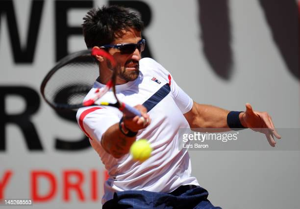 Janko Tipsarevic of Serbia plays a forehand during his match against Philipp Kohlschreiber of Germany during day six of Power Horse World Team Cup at...