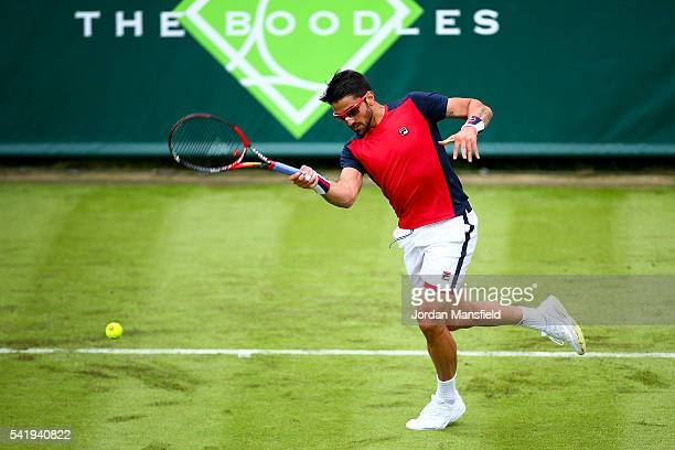 Janko Tipsarevic of Serbia plays a forehand during his match against Nicolas Almagro of Spain during day one of The Boodles Tennis Event at Stoke...