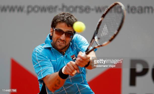 Janko Tipsarevic of Serbia plays a forehand during the red group match between Janko Tipsarevic of Serbia and Daniel GimenoTraver of Spain during day...