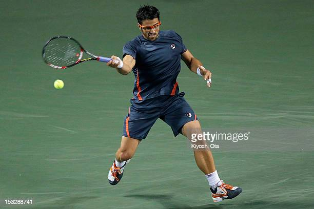 Janko Tipsarevic of Serbia plays a forehand in his first round match against Gilles Simon of France during day three of the Rakuten Open at Ariake...