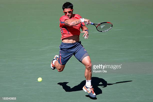 Janko Tipsarevic of Serbia plays a forehand in his second round match against Marco Chiudinelli of Switzerland during day four of the Rakuten Open at...
