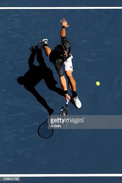 Janko Tipsarevic of Serbia returns a shot against Gael Monfils of France during the men's singles match on day six of the 2010 U.S. Open at the USTA...