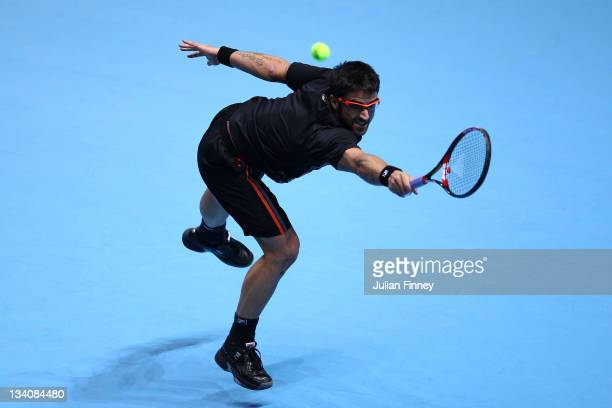 Janko Tipsarevic of Serbia returns the ball during the men's singles match against Novak Djokovic of Serbiaduring the Barclays ATP World Tour Finals...