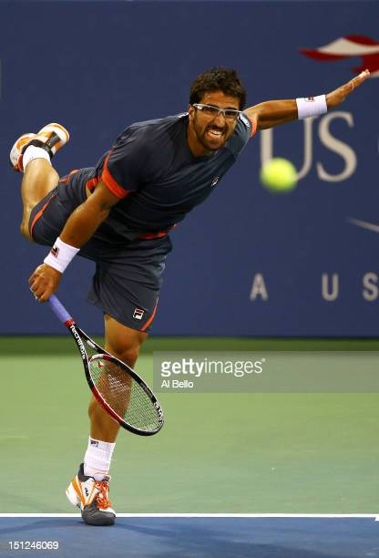 Janko Tipsarevic of Serbia serves during his men's singles fourth round match against Philipp Kohlschreiber of Germany on Day Nine of the 2012 US...