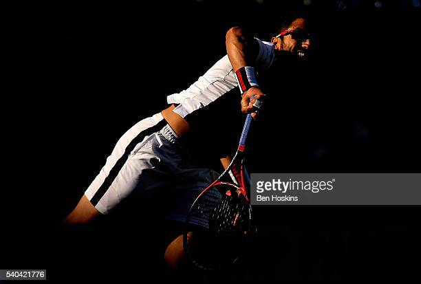 Janko Tipsarevic of Serbia serves during his second round match against Marin Cilic of Croatia on day three of The Aegon Championships at The Queens...