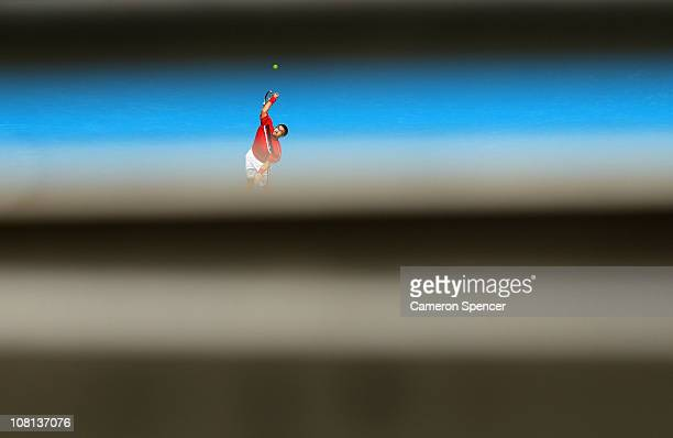 Janko Tipsarevic of Serbia serves in his second round match against Fernando Verdasco of Spain during day three of the 2011 Australian Open at...