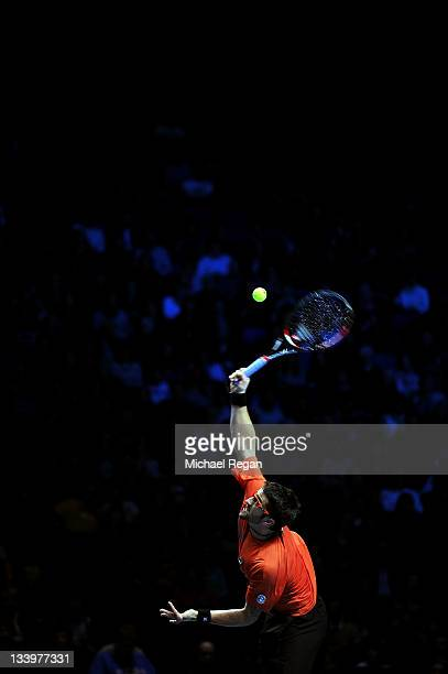 Janko Tipsarevic of Serbia serves the ball during the men's singles match against Tomas Berdych of Czech Republic during the Barclays ATP World Tour...