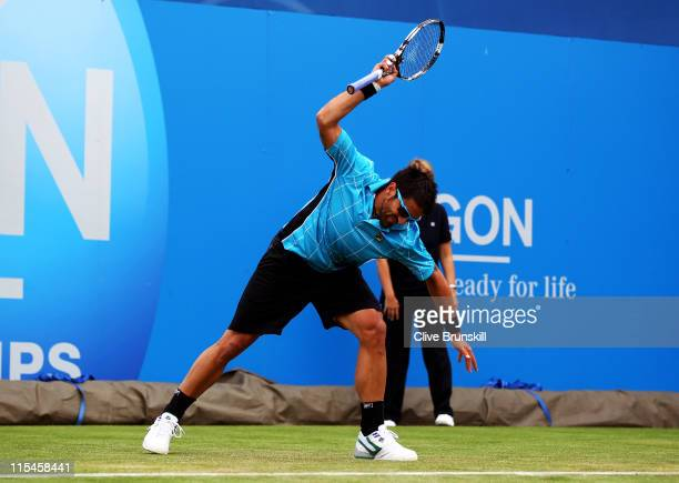 Janko Tipsarevic of Serbia shows his frustration and throws his racket during his Men's Singles first round match against Blaz Kavcic of Slovenia on...