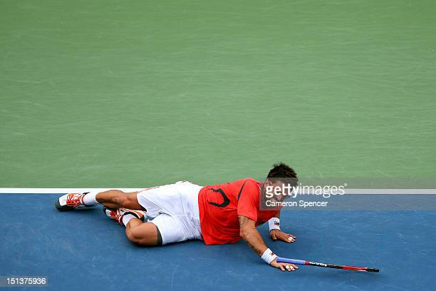 Janko Tipsarevic of Serbia slips on the court against David Ferrer of Spain during their men's singles quarterfinal match on Day Eleven of the 2012...
