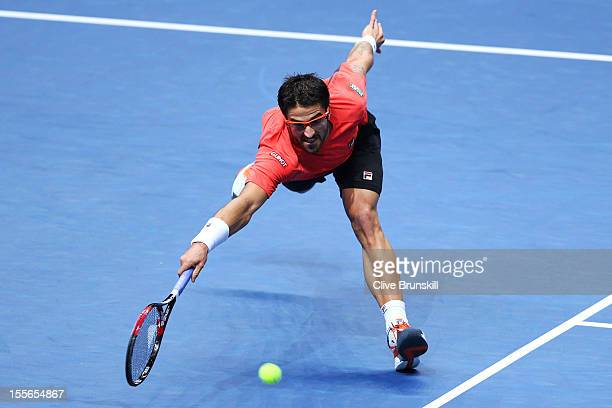 Janko Tipsarevic of Serbia stretches to hit a forehand during the men's singles match against Roger Federer of Switzerland on day two of the ATP...