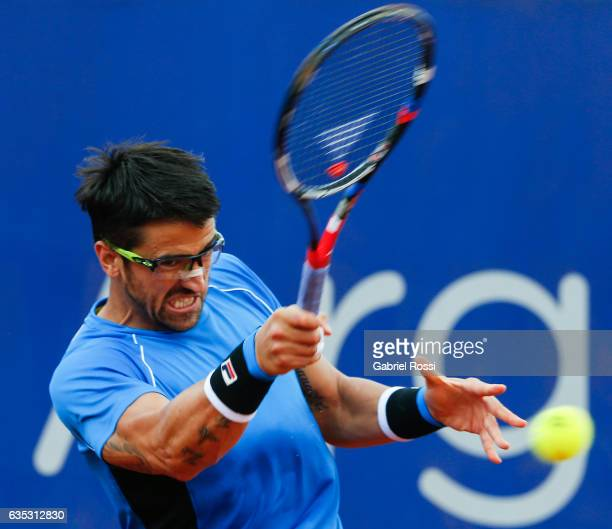 Janko Tipsarevic of Serbia takes a forehand shot during a first round match between Alexandr Dolgopolov of Ukraine and Janko Tipsarevic of Serbia as...