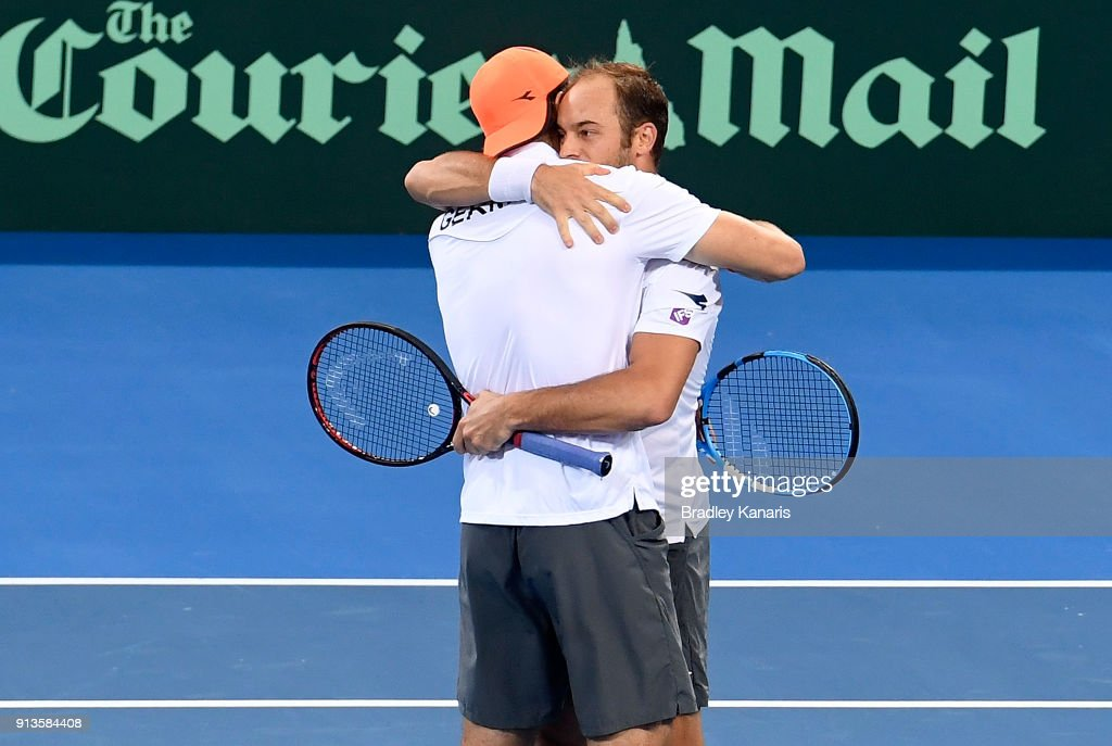 Jan-Lennard Struff and Tim Putz of Germany celebrate victory in the doubles match against Matt Ebden and John Peers of Australia during the Davis Cup World Group First Round tie between Australia and Germany at Pat Rafter Arena on February 3, 2018 in Brisbane, Australia.