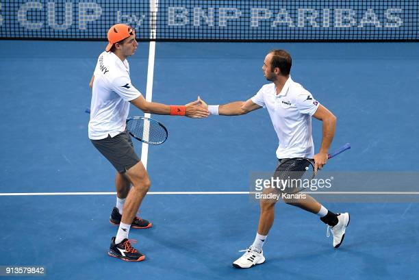 JanLennard Struff and Tim Putz of Germany celebrate winning point in the doubles match against Matt Ebden and John Peers of Australia during the...