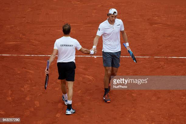 JanLennard Struff and Tim Putz of Germany celebrates a point in their doubles match against Feliciano Lopez and Marc Lopez of Spain during day two of...