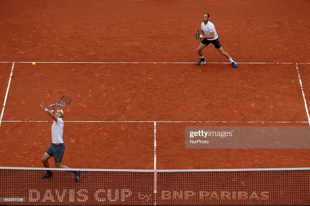 Jan-Lennard Struff (L) and Tim Putz of Germany in action in their doubles match against Feliciano Lopez and Marc Lopez of Spain during day two of the Davis Cup World Group Quarter Finals match between Spain and Germany at Plaza de Toros de Valencia on April 7, 2018 in Valencia, Spain